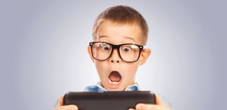 Surprised child with tablet, in-app purchases
