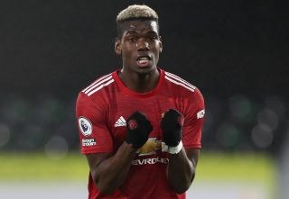 Manchester United's Paul Pogba celebrates after the final whistle during the Premier League match at Craven Cottage, London. Picture date: Wednesday January 20, 2021.
