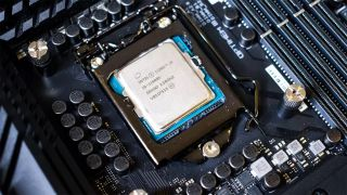 An Intel Core i9-11900K socketed into a motherboard