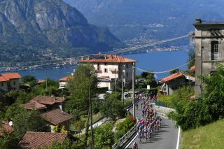 The peloton begins the picturesque ascent of Madonna del Ghisallo from Bellagio Village on the shores of Lake Como