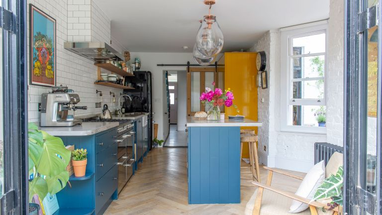 Shoe designer Jacqueline has filled her renovated Edwardianhome with vintage furniture, art, plants and curios from Her travels