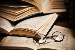 Glasses sitting on open books.