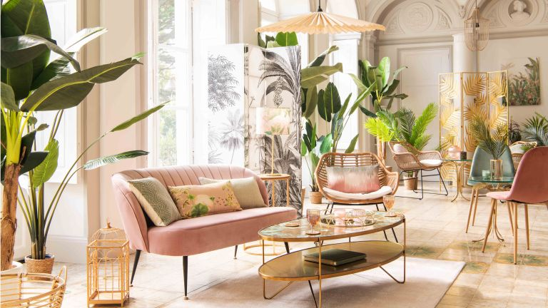 living room sofa pink green plants velvet coffee table chair screen windows