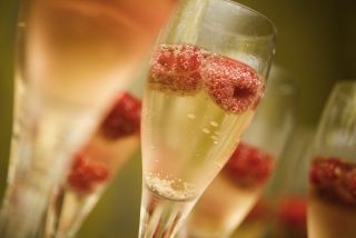 Champagne or sparkling wine with raspberries.