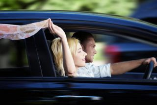 Couple riding in a car at high speed