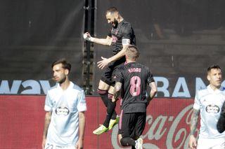 Karim Benzema scored twice as Real Madrid won their LaLiga trip to Celta Vigo.