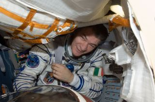 European Space Agency astronaut Paolo Nespoli, Expedition 27 flight engineer, attired in a Russian Sokol launch and entry suit, is pictured in the Soyuz TMA-20 spacecraft currently docked to the Rassvet Mini-Research Module 1 (MRM1) of the International S
