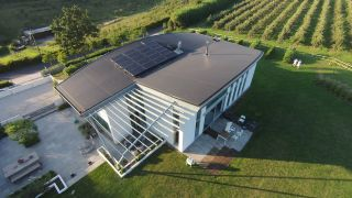 Hybrid solar panels installed on modern self build