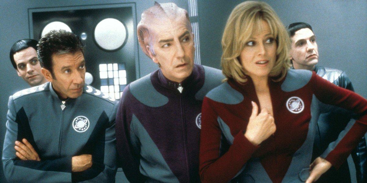 Galaxy Quest Tim Allen, Alan Rickman, and Sigourney Weaver standing on the bridge, in conversation
