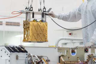Engineers lowered MOXIE into the Mars Perseverance rover in March 2019.