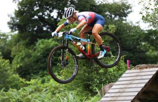 IZU JAPAN JULY 27 Evie Richards of Team Great Britain jumps during the Womens Crosscountry race on day four of the Tokyo 2020 Olympic Games at Izu Mountain Bike Course on July 27 2021 in Izu Shizuoka Japan Photo by Tim de WaeleGetty Images