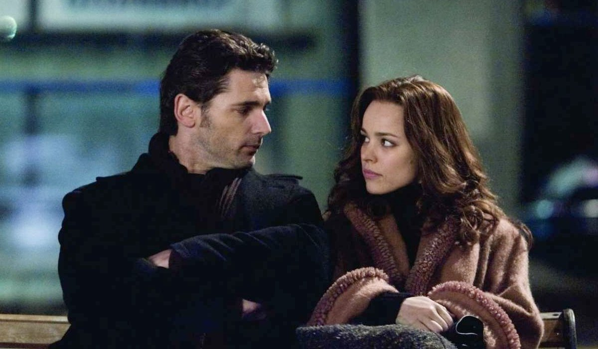 Eric Bana and Rachel McAdams share a meaningful look on a bench in The Time Traveler's Wife.