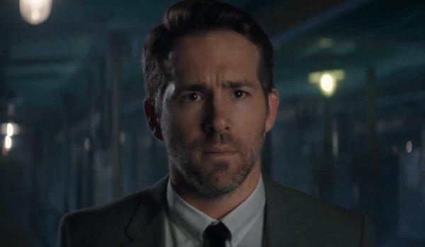 The Hitman's Bodyguard an upset Ryan Reynolds in a dark lit room