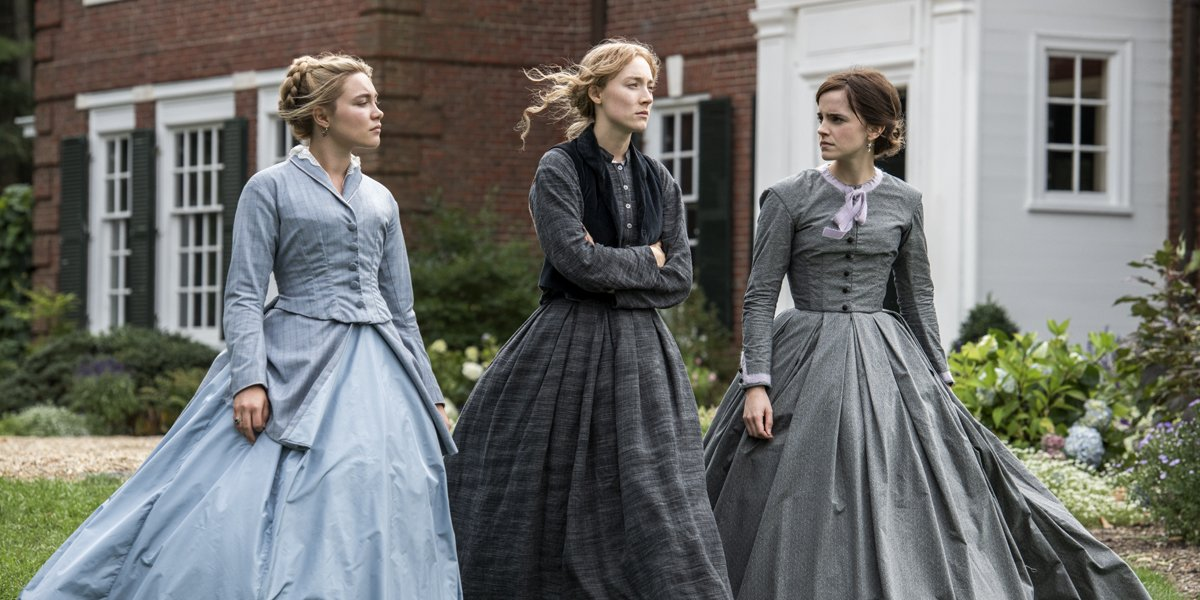 Three ladies stand together in Little Women