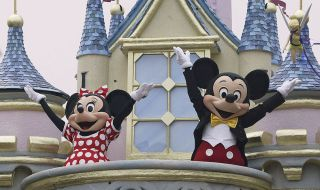 Mickey Mouse and Minnie Mouse perform during a parade at Hong Kong Disneyland on Sept. 11, 2005.
