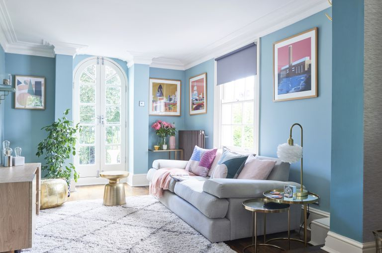 blue living room with grey sofa