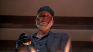 The Dark Half Timothy Hutton toasts over a fire