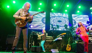 (left to right) Steve Howe, Geoff Downes and Jon Davison perform on stage with Yes on August 18, 2014 in San Diego, California