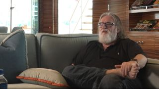 Gabe Newell sat on a sofa, barefoot, talking about brain-computer interface technology