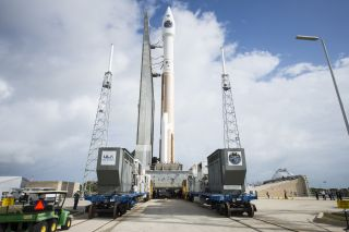 A United Launch Alliance Atlas V rocket carrying NASA's four Magnetospheric Multiscale mission satellites rolls out to the launch pad at Cape Canaveral Air Force Station in Florida one day before its planned March 12, 2015 launch. The mission will study m