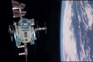 "R2-D2 flies to the International Space Station to help a NASA astronaut beam a ""Star Wars Day"" message down to Earth."