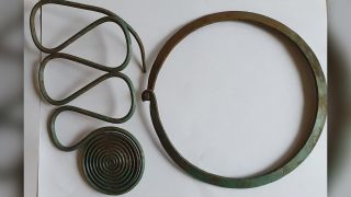 The hoard's contents included this large hook with spirals, as well as this neck ring.