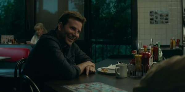 The Mule Bradley Cooper smiles and laughs at a diner counter