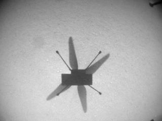 NASA's Mars helicopter Ingenuity took this photo of its own shadow with its navigation camera during its seventh Red Planet flight, on June 8, 2021.