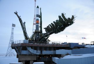 A Russian Soyuz rocket carrying the Progress 69 cargo ship stands atop its launchpad at the Baikonur Cosmodrome in Kazakhstan.