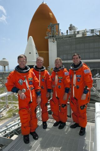 STS-135 Crew Members After Training