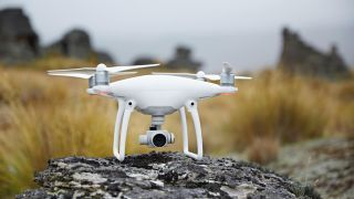 The best camera drones: The DJI Phantom Pro 4 V2.0 sitting on a rock