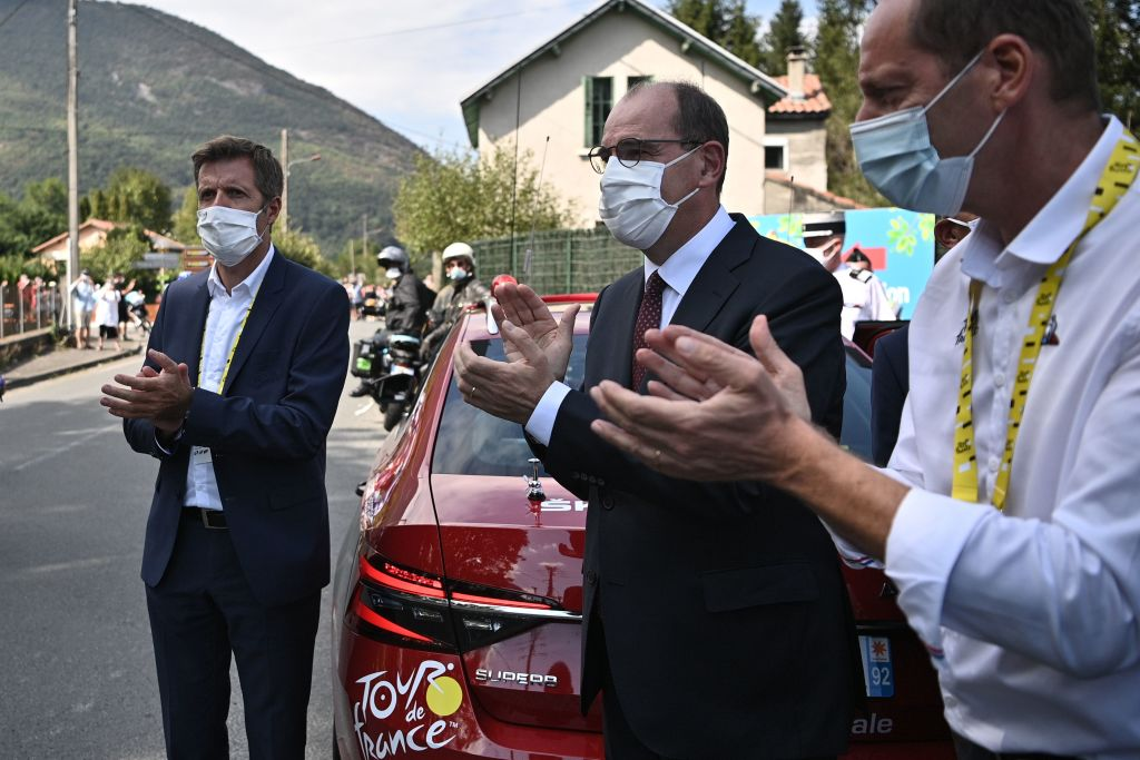 From R Tour de France Director Christian Prudhomme and French Prime Minister Jean Castex applaud the riders during the 8th stage of the 107th edition of the Tour de France cycling race 140 km between CazeressurGaronne and Loudenvielle on September 5 2020 Photo by AnneChristine POUJOULAT AFP Photo by ANNECHRISTINE POUJOULATAFP via Getty Images