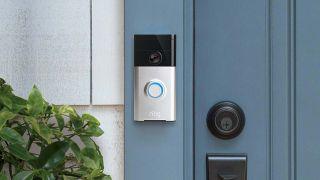 ring video doorbell pictured on a blue door