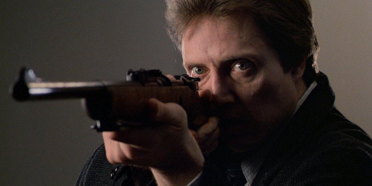 Christopher Walken as Johnny Smith aiming a gun in The Dead Zone
