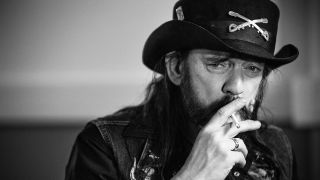 A black and white photograph of Motorhead's Lemmy smoking a cigarette