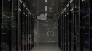 server room overlaid with graphical representation of cloud computing networks