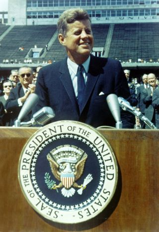 President Kennedy speaks before a crowd of 35,000 people at Rice University in the football field.