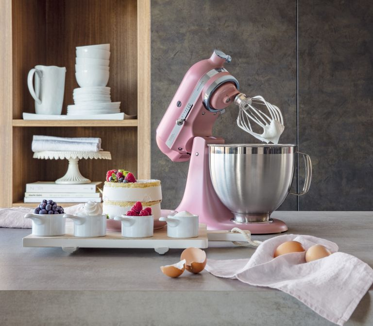 Bake off style kitchen with pink stand mixer