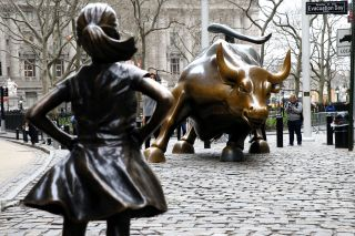 "The ""Fearless Girl"" statue was installed in front of the bronze ""Charging Bull"" in New York City for International Women's Day in March 2017, to draw attention to the gender pay gap and lack of gender diversity on corporate boards in the financial sector."