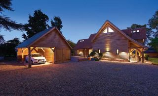 outbuilding-cum-garage designed 9along with the main house by Pete Tonks and built by Oakwrights