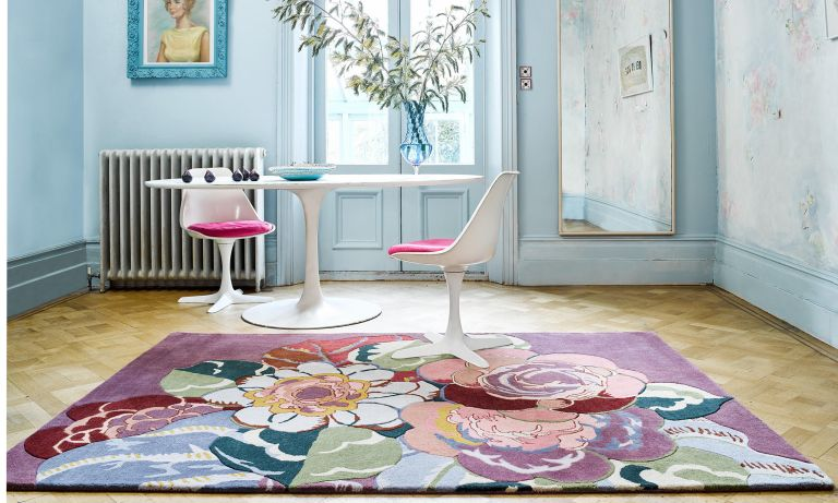 Rosa floral print rug in a dining corner