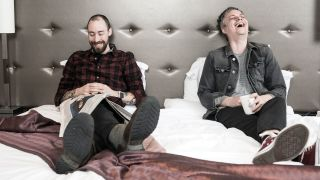 British Theatre's Vennart and Ingram laughing on a hotel bed