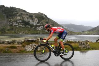LAGOS DE COVADONGA SPAIN SEPTEMBER 01 Odd Christian Eiking of Norway and Team Intermarch Wanty Gobert Matriaux Red Leader Jersey competes during the 76th Tour of Spain 2021 Stage 17 a 1855km stage from Unquera to Lagos de Covadonga 1085m lavuelta LaVuelta21 on September 01 2021 in Lagos de Covadonga Spain Photo by Tim de WaeleGetty Images