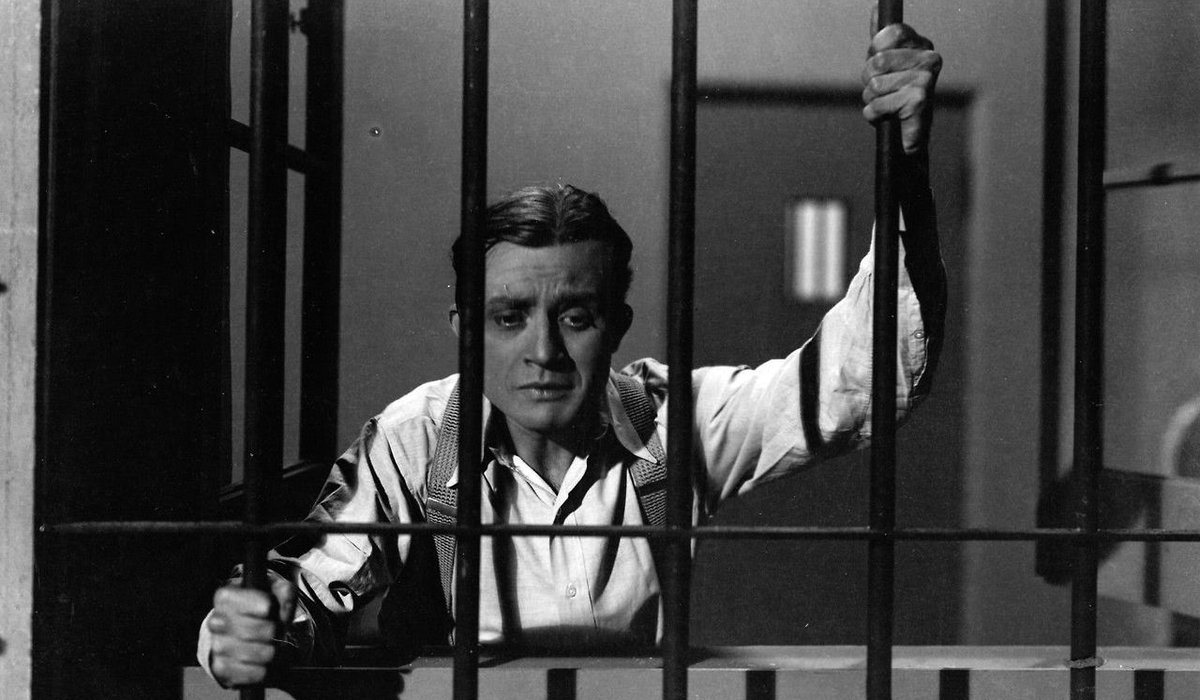 Dracula Renfield behind bars, looking for his master