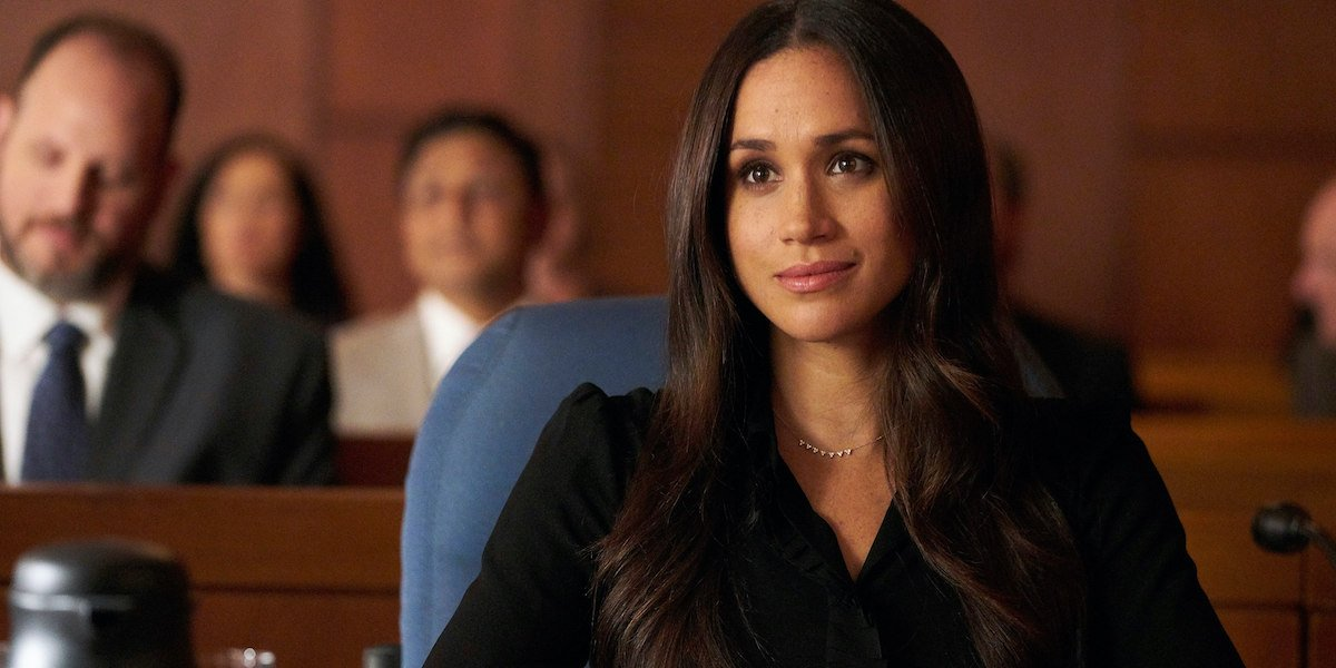 Rachel (Meghan Markle), listens intently from her seat in a court room in 'Suits'