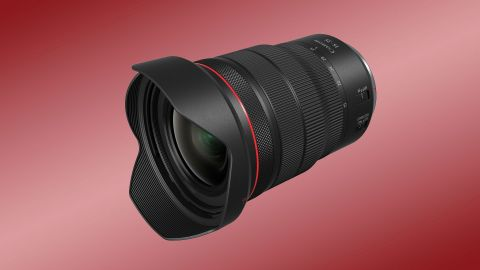 Canon RF 15-35mm f/2.8L IS USM lens review: Image shows the lens against a red backdrop.