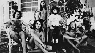 Supertramp relaxing in the summertime with swimming trunks, circa 1974