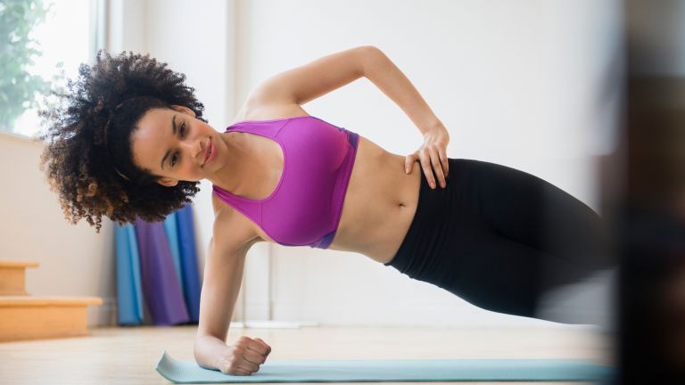 Woman doing the side plank as part of her core exercises