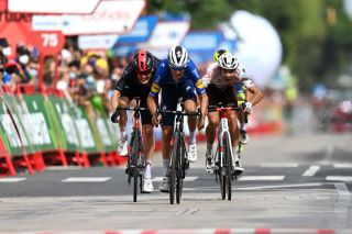 RINCON DE LA VICTORIA SPAIN AUGUST 24 LR Dylan Van Baarle of Netherlands and Team INEOS Grenadiers Mauri Vansevenant of Belgium and Team Deceuninck QuickStep and Clment Champoussin of France and AG2R Citren Team sprint at finish line during the 76th Tour of Spain 2021 Stage 10 a 189km stage from Roquetas de Mar to Rincn de la Victoria lavuelta LaVuelta21 on August 24 2021 in Rincon De La Victoria Spain Photo by Stuart FranklinGetty Images