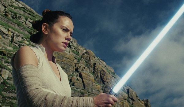 Rey holding Anakin Skywalker's Lightsaber